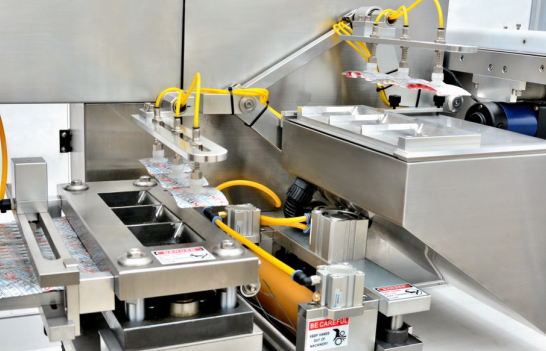 Blister Packaging Line adopts vacuum arm to collect blister cards