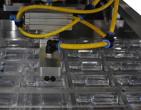 Blister Packaging Machine, placed ampoules into the formed web