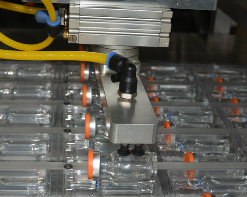Blister Packaging Machine, placed the vials into formed web.